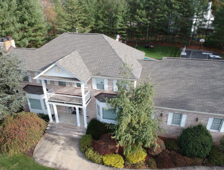 A drone shot of a home's newly completed roof.