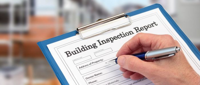 person filling out building inspection report