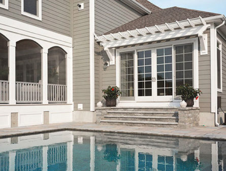 Celect siding is installed across this lovely home, with the pool reflecting its beauty.