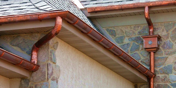 A fresh set of copper gutters have been applied to this home.