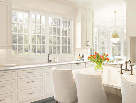 This white kitchen has had new windows installed by the team at Blue Nail.
