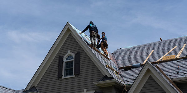 Contractors working on a roof in Denville New Jersey