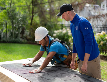 The Blue Nail team getting the roofing material ready.